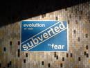 eastville underpass fly poster graffiti evolution of man subverted by fear, bristol, united kingdom (uk).